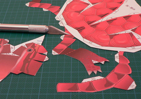 cutting out the paper model pieces