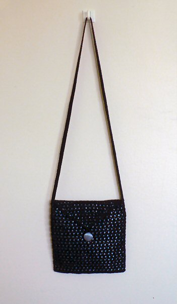 black crocheted bag with blue satin lining