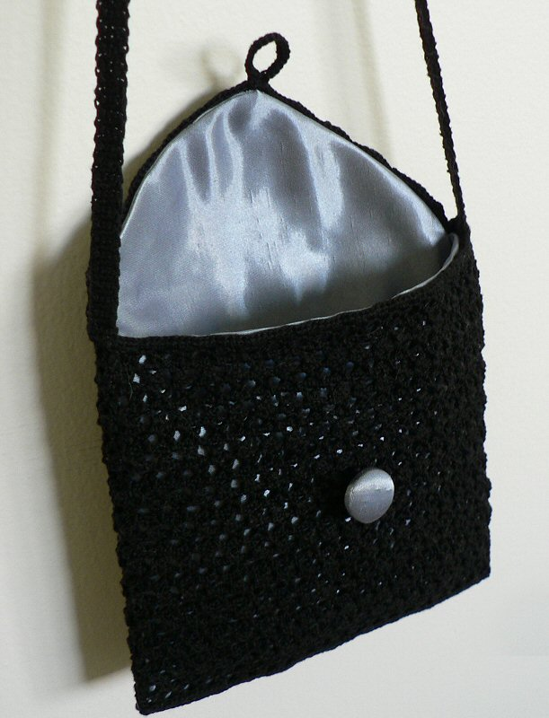 open bag showing blue satin lining