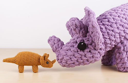 Giant Amigurumi Triceratops Dinosaur by PlanetJune together with a standard-sized triceratops