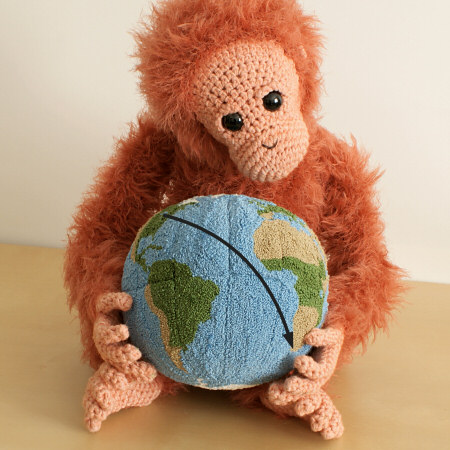 punchneedle globe (with crocheted orangutan) by planetjune
