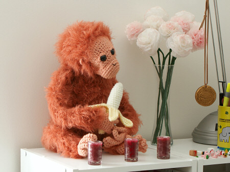 crocheted orangutan and tissue paper flowers by planetjune