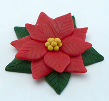 polymer clay poinsettia by planetjune