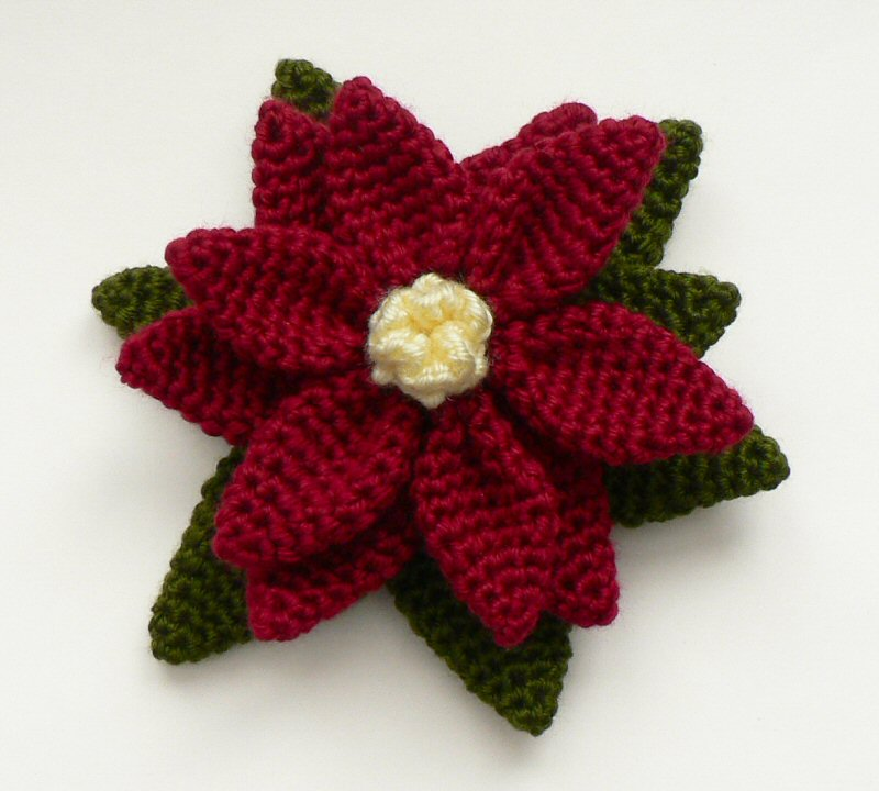 crocheted poinsettia by planetjune