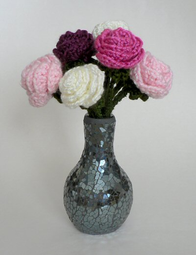 vase of crocheted roses by planetjune