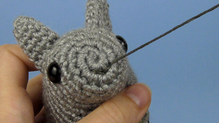 secure stitching for amigurumi faces and embellishments, by planetjune