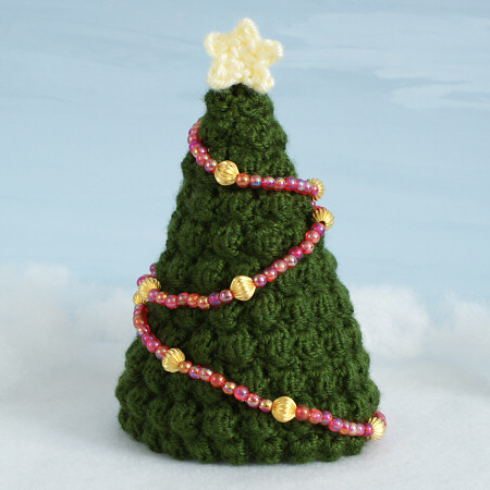 crocheted Christmas trees by planetjune