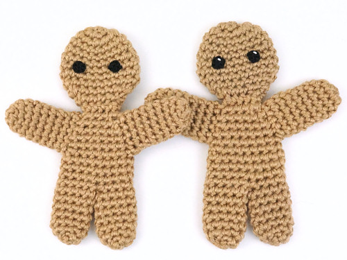 Gingerbread Man (crochet pattern by PlanetJune) with and without a glint in the eye